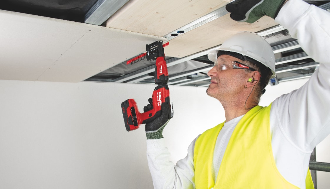Image of drywall being installed overhead using collated screws, a screw magazine and the new SD 5000-A22 cordless drywall screwdriver
